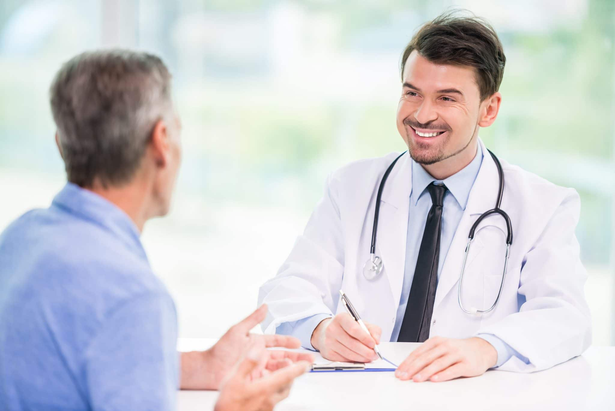 Doctor Speaking to Older Man About TriMix Injections