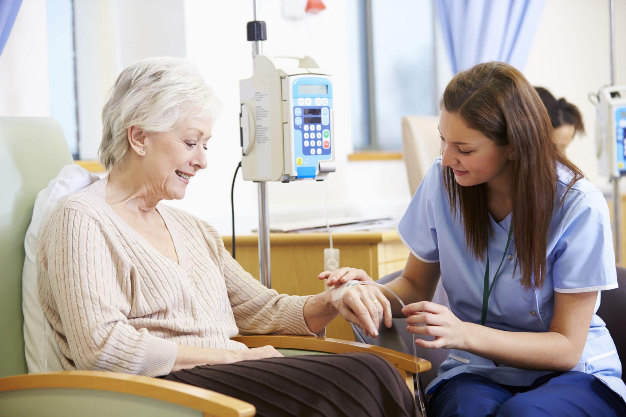 Doctor administering IV on a senior woman patient – Understanding What Is Vitamin IV Therapy?