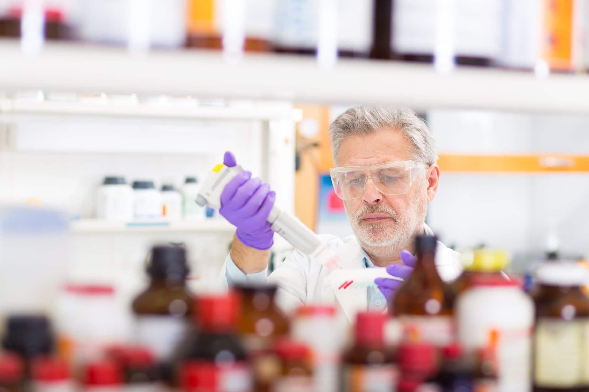 Pharmacist customizing medication