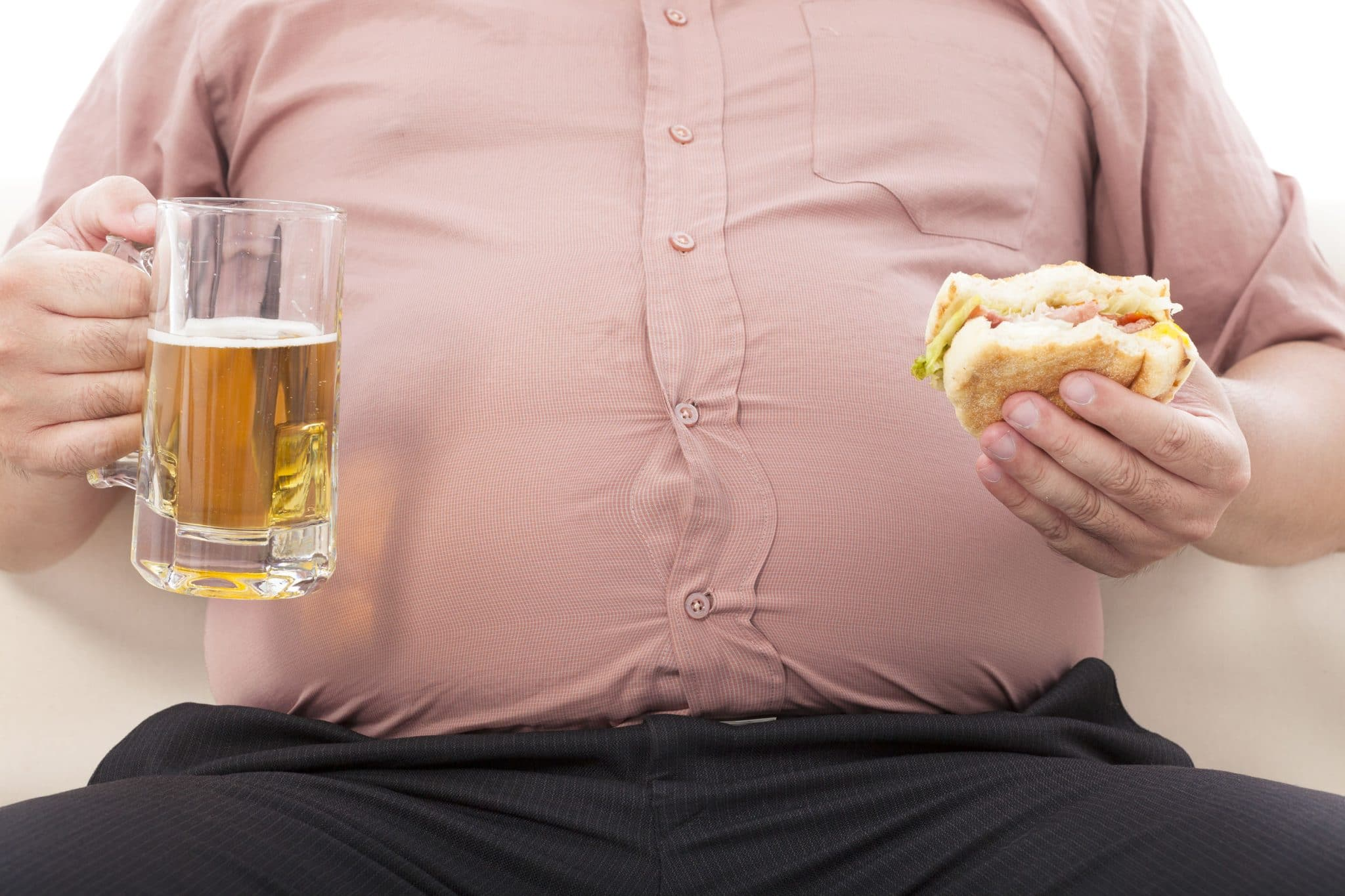 Overweight Man Drinking Beer and Eating Burger
