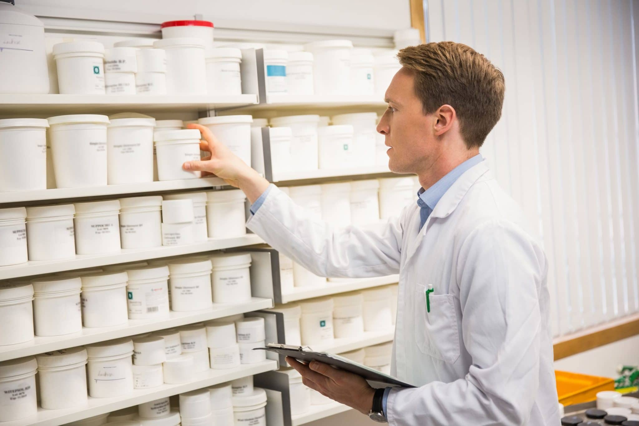 Compounding Pharmacist Checking Medications
