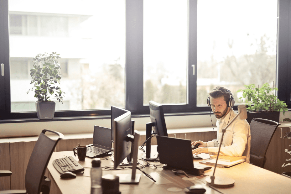 Man on Computer with Headphones