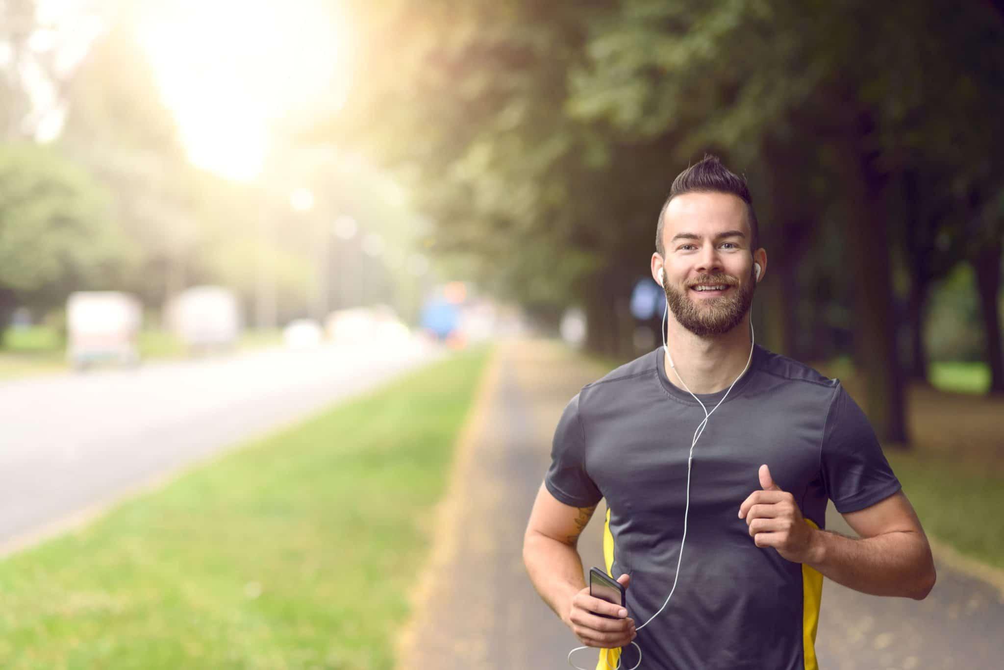 young athletic man jogging outside — IV Vitamin Therapy Benefits
