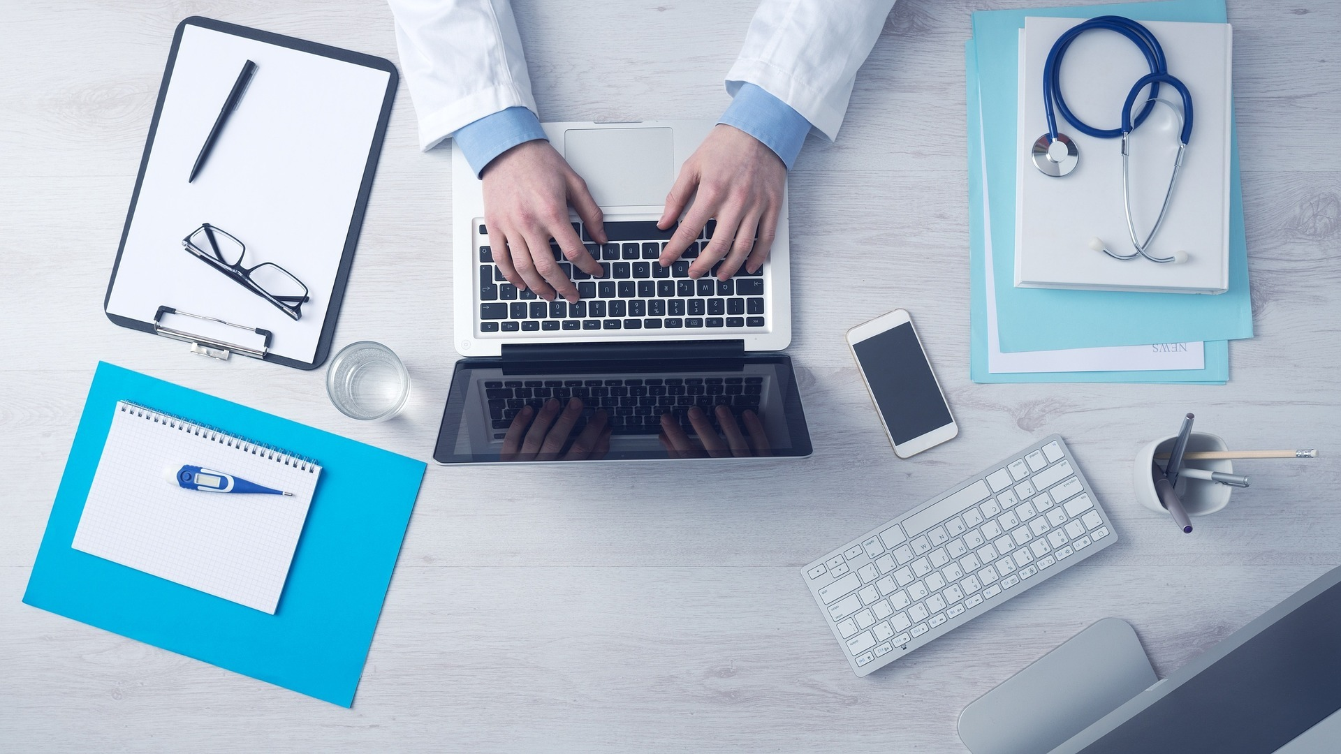 Doctor Typing on Laptop to Order TriMix Injections Online