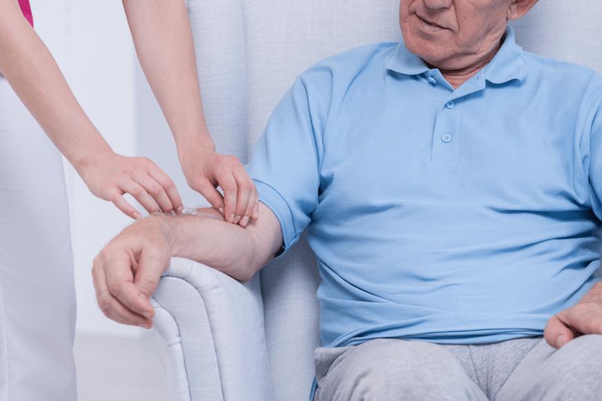 Older Male Patient Receiving IV